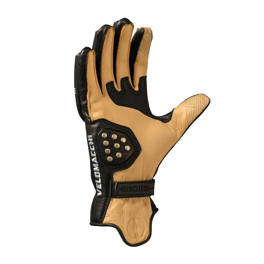 Patterned fourchettes between the glove fingers provides better dexterity while on a motorcycle.