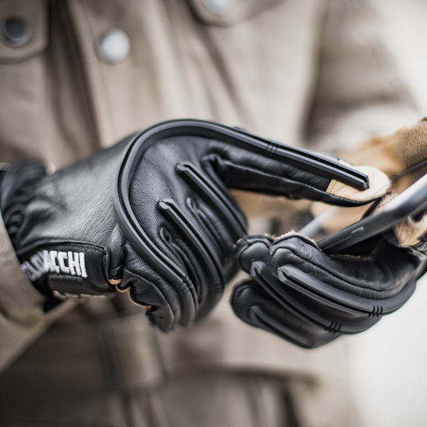 These tan and black motorcycle gloves feature conductive finger and thumb tips for touch screen navigation on your smartphone.