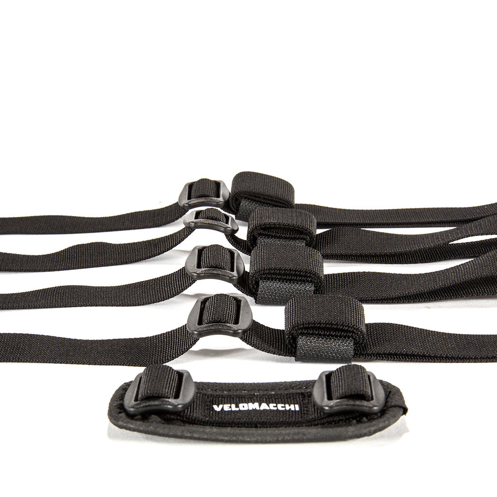 These motorcycle tie down straps feature Velcro male and female tabs to manage excess webbing when motorcycle commuting.