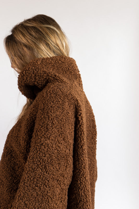 Curly Turtleneck in Rust