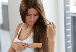 Brunette showing hair repair of dry brittle hair using ST. TROPICA natural hair products