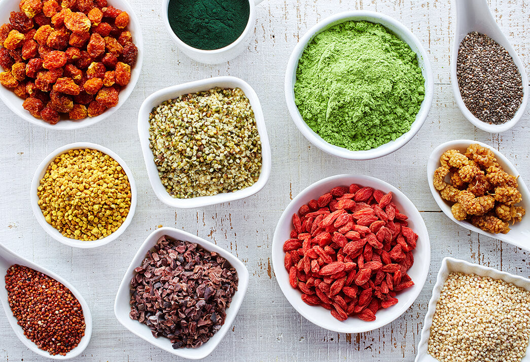 An image of hair superfood ingredients in different bowls for a healthy hair growth