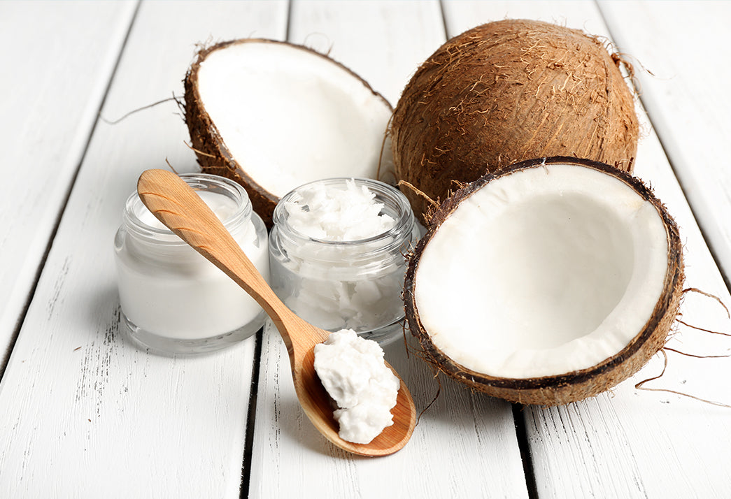 Coconut oil hair image with husk and white coconut meat | ST. TROPICA Hair Mask