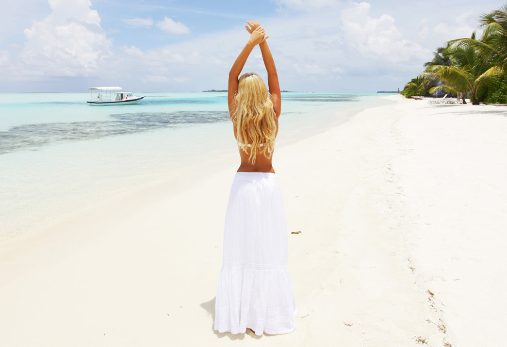 The quest for Healthy Hair with girl along the white sand