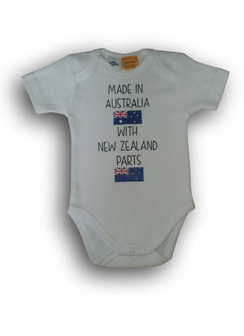 Made in _______ with _______ parts (tees and onesies)
