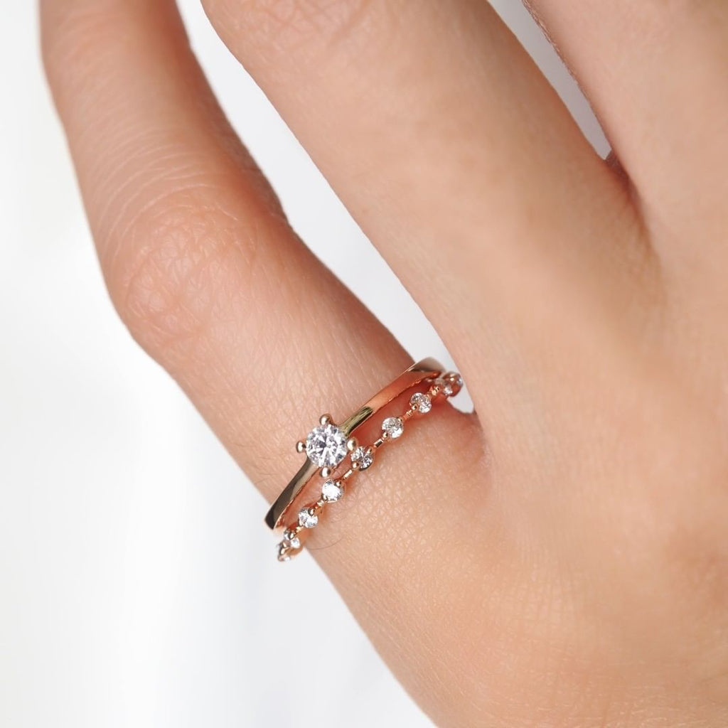 0.11 CT. DIAMOND SOLITAIRE RING