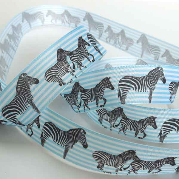 Ribbon with zebras in front of blue stripe background