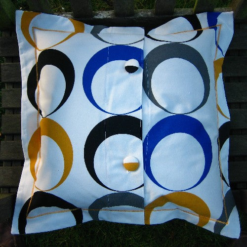 Eclipse Circles Cushion, Handmade in a Cotton Blue and Gold Eclipse Print with Satin Stitch embroidery, 21 inch x 21 inch, 53 cm x 53 cm