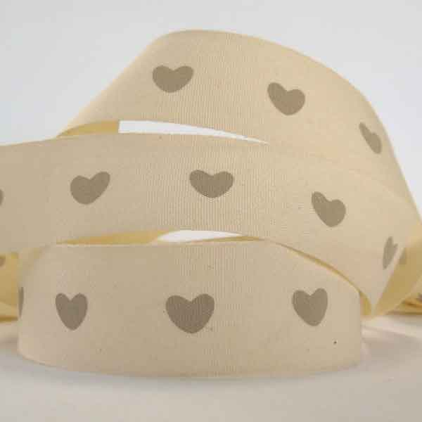 Cream ribbon with hearts design