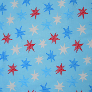 Red white and blue shooting stars on blue fabric