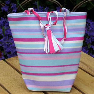 Ribbons and Stripes Bucket Handbag with Ribbon Tassel and Loop Closure and Knotted Ribbon Handles, handmade in pure cotton and fully lined.