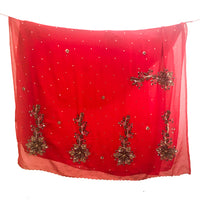 Heavily ornamented red recycled chiffon sari.