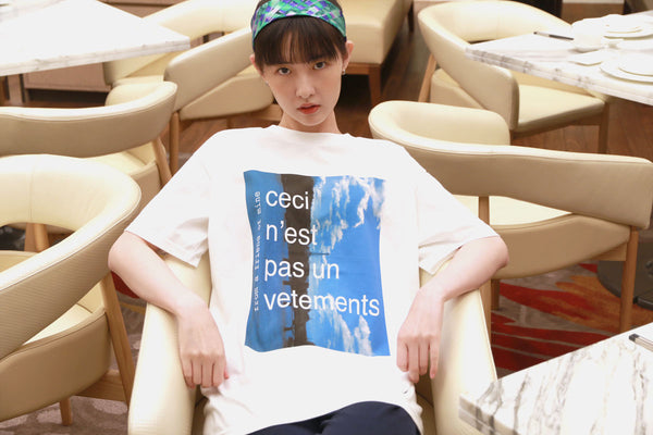 "Printed white T-shirt ""Ceci n'est pas un vetements"" from a friend of mine online paris taipei tokyo"