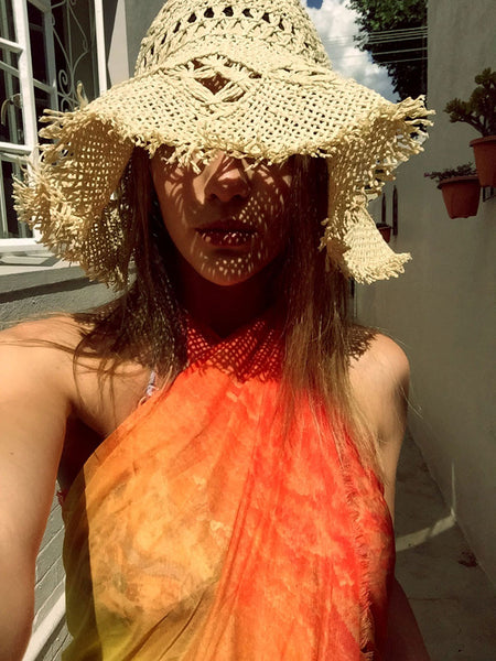 Buy stylish orange sarong, beachwear and wraps for women; perfect luxury accessories for summer.