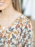 Fair Haven Floral Peplum Top