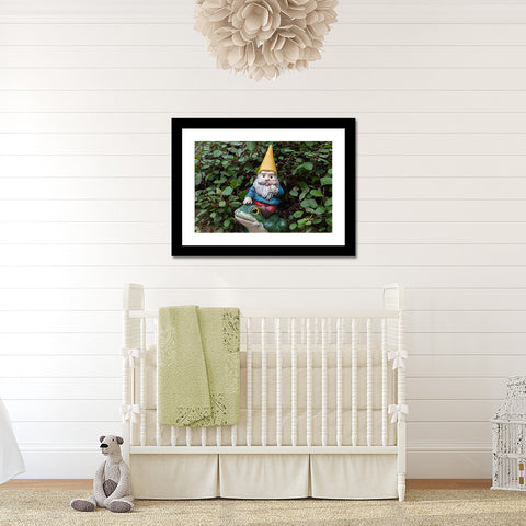 This gnome photo features a cute garden gnome with a yellow hat riding his frog emerging from the forest, deciding where to go next. This garden gnome print is the perfect addition for a kids room, nursery, or anywhere you would display whimsical art.