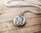 Tiny Anatomical Heart Necklace in Silver