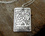 Sea Turtles Necklace in Silver