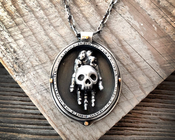 Hand Holding Skull Necklace in Sterling Silver