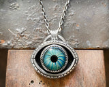 Evil eye necklace with blue green eye