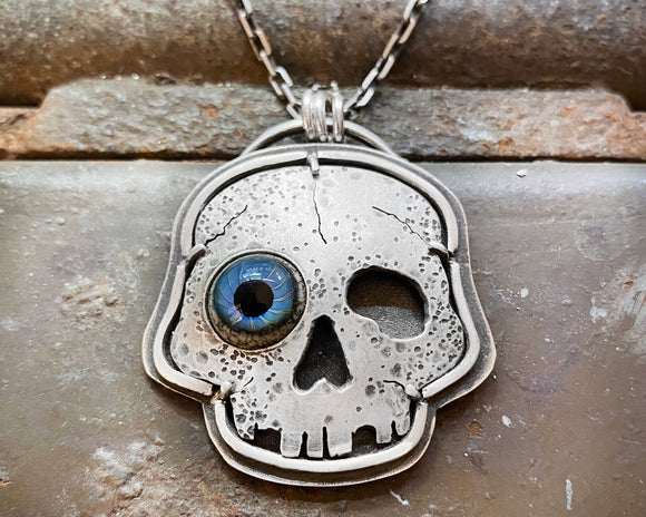 Wonky eye skull necklace in sterling silver with glass eye
