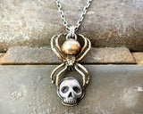 Bronze Black Widow Spider Holding Sterling Skull Necklace