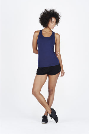 Girl woman wearing BAM.U bamboo navy singlet over BAM.U black bamboo short shorts