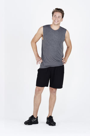 Guy wearing charcoal BAM.U bamboo training muscle tank over black BAM.U training basketball bamboo shorts smiling