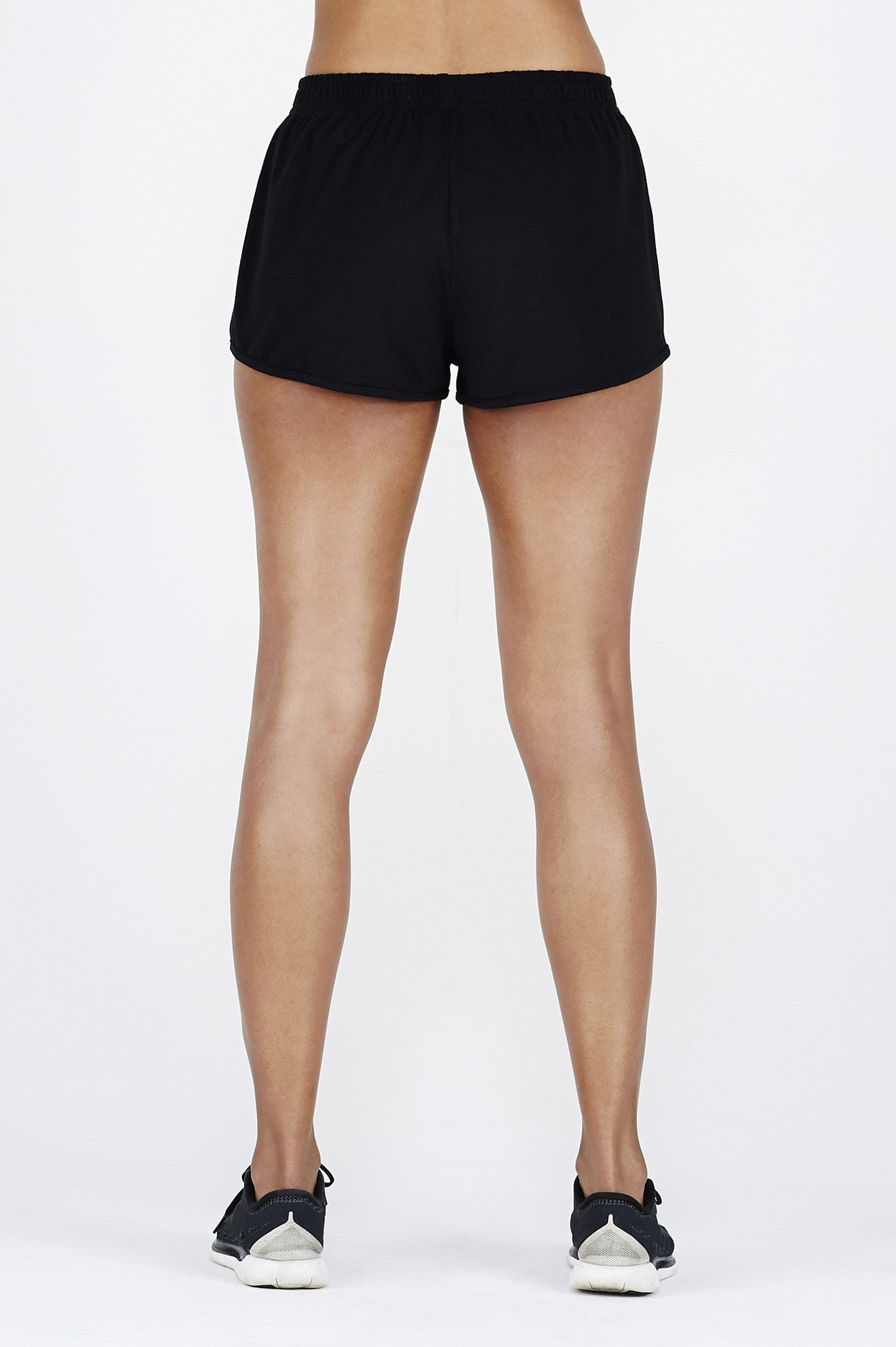 Woman's legs back wearing BAM.U bamboo black short shorts gym shorts