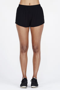Woman's legs wearing BAM.U bamboo black short shorts gym shorts