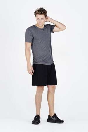 Guy wearing charcoal BAM.U warm-up tee tshirt over black BAM.U training basketball bamboo shorts