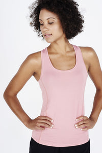 Woman with afro wearing coral BAM.U bamboo racer back singlet tank over black BAM.U gym run shorts in bamboo