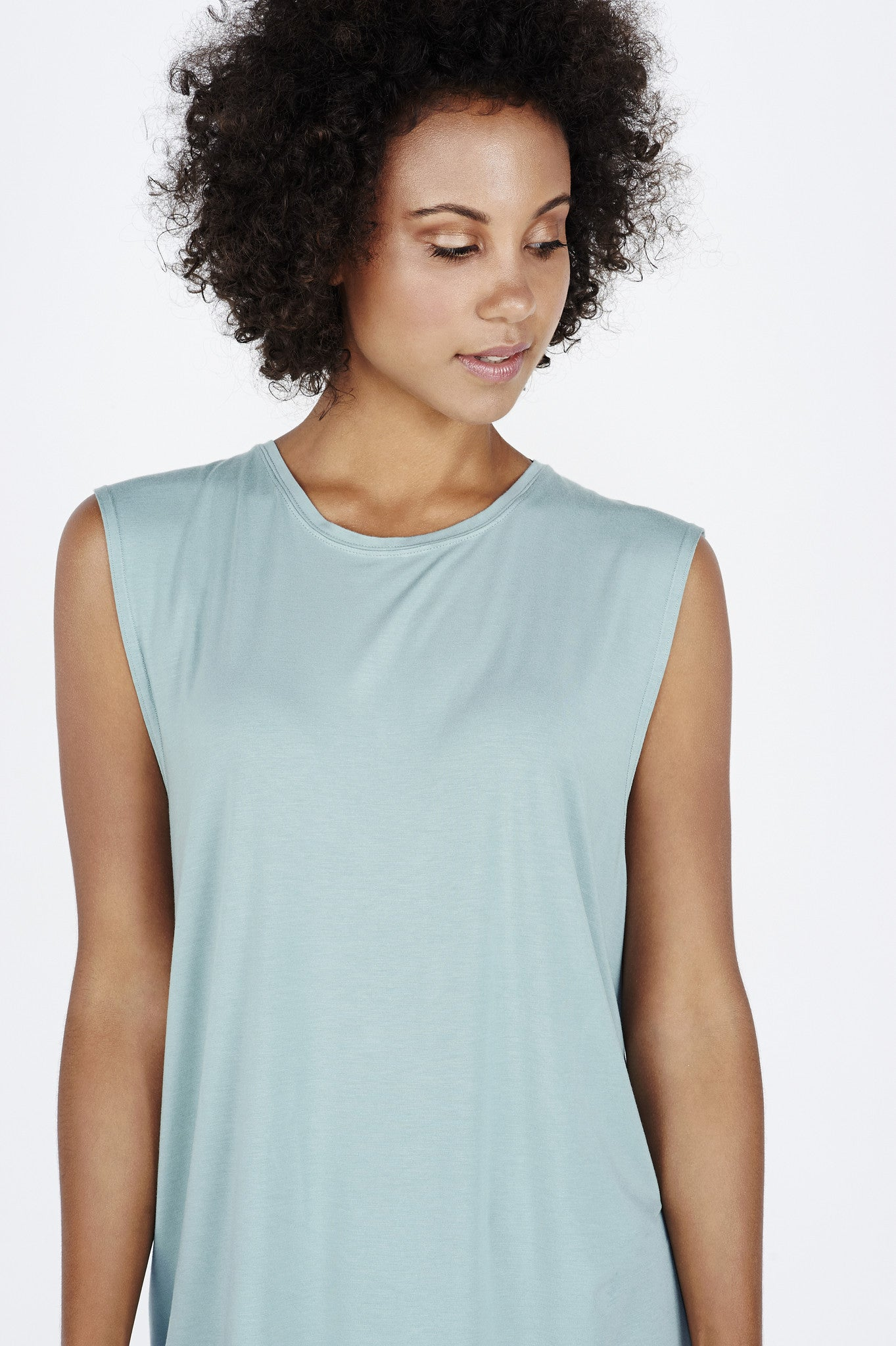 Woman with afro wearing teal BAM.U bamboo muscle tank