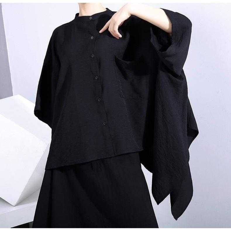 Asymmetrical Black Ruffled Blouse
