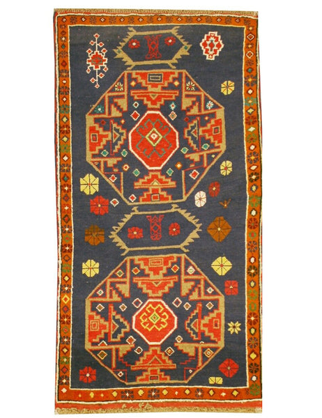 BALOUCH NOMAD RUG FROM THE HANDMADE RUG COMPANY