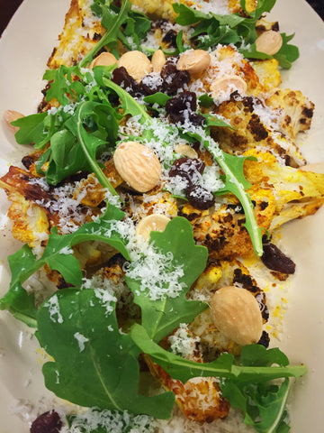 Roasted, Spiced Cauliflower with Marcona Almonds, Raisins and Arugula