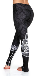 High waisted leggings with white lotus flower made from premium grade eco friendly recycled fabrics back view