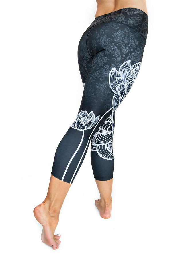 High waisted capri with white lotus flower made from premium grade eco friendly recycled fabrics back view