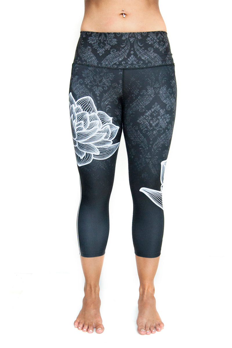 High waisted capri with white lotus flower made from premium grade eco friendly recycled fabrics front view