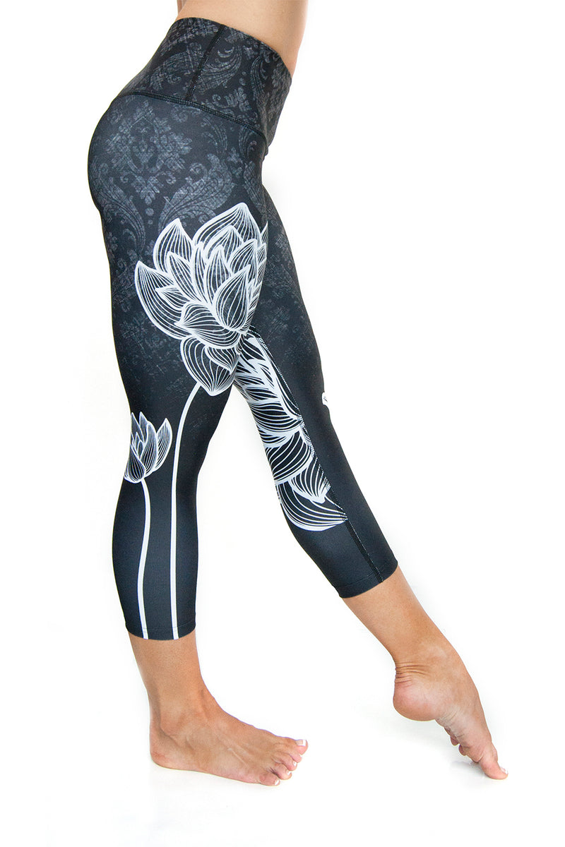 High waisted capri with white lotus flower made from premium grade eco friendly recycled fabrics right view