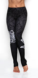 Black patterned high waisted leggings with white lotus flower made from premium grade eco friendly recycled fabrics front view