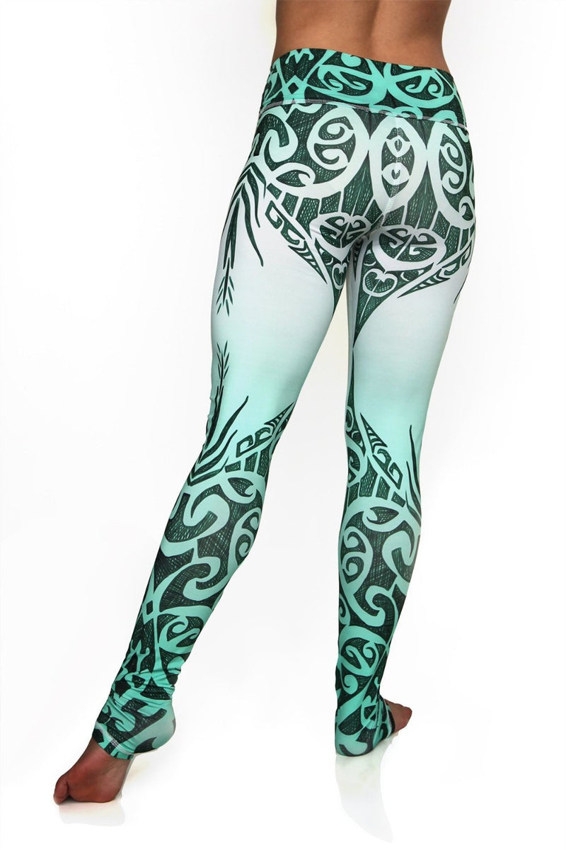 Jade Queen high waisted extra long yoga pants with exotic green and white tribal design made from premium sweat wicking fabrics. Cute unique leggings back view