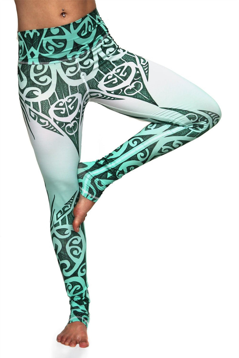 Jade Queen high waisted extra long yoga pants with exotic green and white tribal design made from premium sweat wicking fabrics. Cute unique leggings tree pose