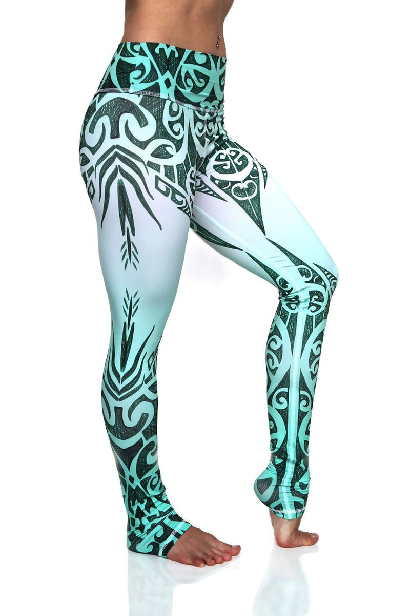 Jade Queen high waisted extra long yoga pants with exotic green and white tribal design made from premium sweat wicking fabrics. Side view