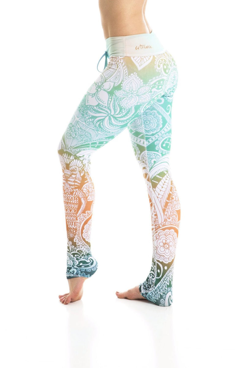 Om Shanti tropical colors High waist drawstring leggings made from premium eco friendly compression fabrics. Mint green pattern. Elephant leggings. Uniquely yoga boutique. side view.