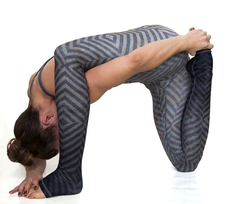 Mystic high waist extra long ultra soft compression yoga pants from Niyama Sol. Olive green blue grey ombre diamond design with You are Unique printed on inside of fold down waistband. Eco friendly recycled fabric available from Uniquely Yoga. Box Yoga Pose