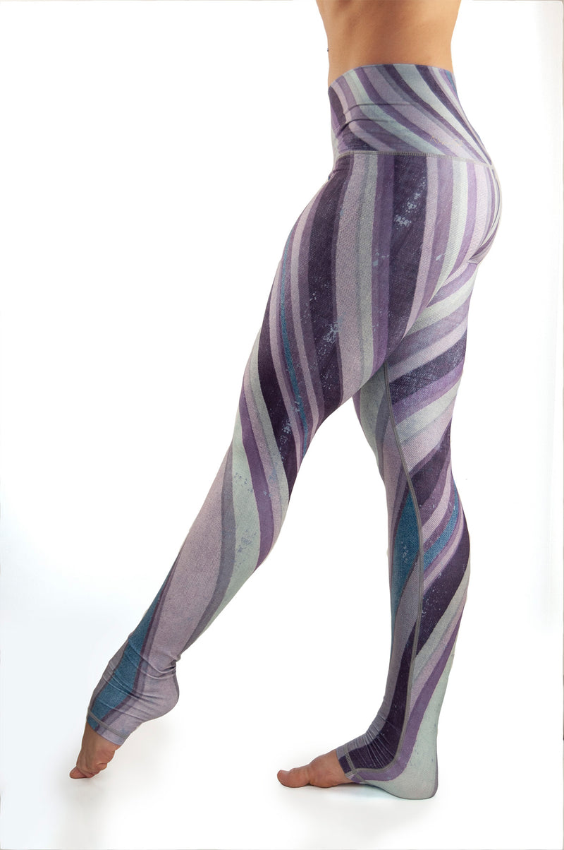 Purple Haze workout leggings from Niyama Sol.  High waist extra long ultra soft compression yoga pants made from eco friendly recycled fabric. Available from Uniquely Yoga boutique.  Side View