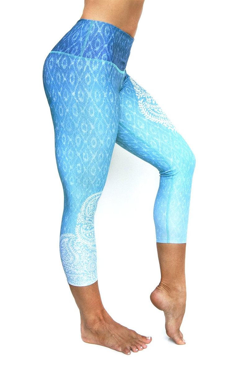Reflection Blue green white ombre high waisted compression capri with asymmetrical white  pattern on side over water reflection print from Inner Fire. Premium fabrics made from recycled water bottles. Right Side view
