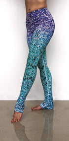 Mosaic Mermaid high waist extra long leggings made from lux eco friendly fabrics. Blue green purple ombre. Available from Uniquely Yoga. Side view