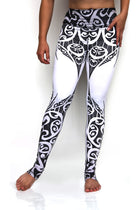 Tribal leggings high waisted extra long yoga pants with exotic black and white tribal design made from premium eco friendly fabrics. Front view. Available from Uniquely Yoga Boutique